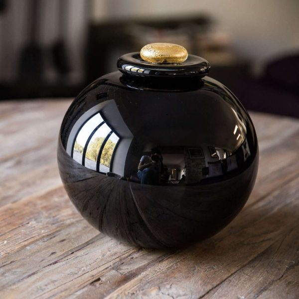 Full sized urn with gold leaf pebble stopper