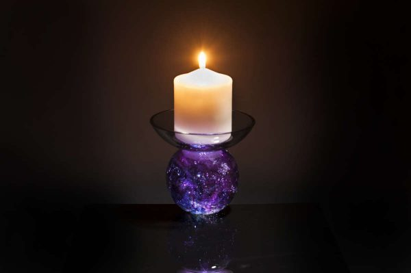 Spherical cremation ashes in glass candle holder