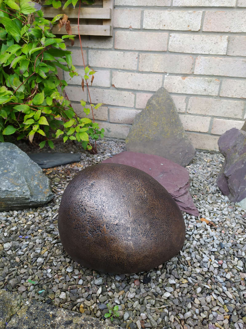 Traditional-Bronze-Out-door-Urn for ashes in domestic setting